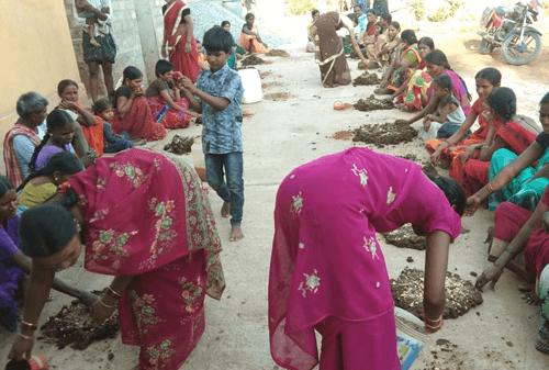 Women preparing natural fertilizer